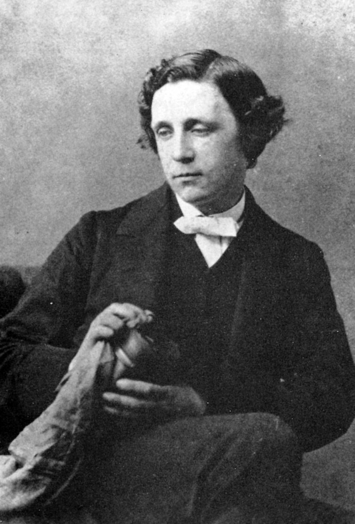 Lewis Carroll - polishing a camera lens? Photograph by Oskar Gustav Rejlander