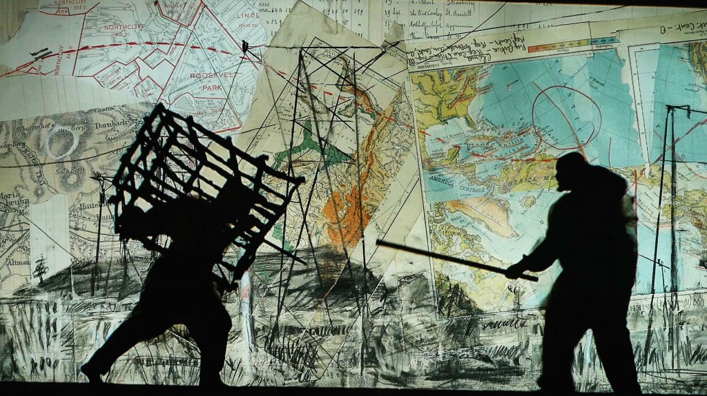 Kentridge - Notes Towards A Model Opera - cage and stick on map